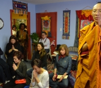 Lama Youngtong Tenzin, YYEF's in-residence Bdon monk, presides along with Jetsun Ma's assistance.  As participants participated.