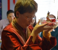 When an existing Buddha statue pledger is not able to attend in person, Jetsun Ma offers to re-affirm his/her pledge and receives Buddha's blessings on their behalf.